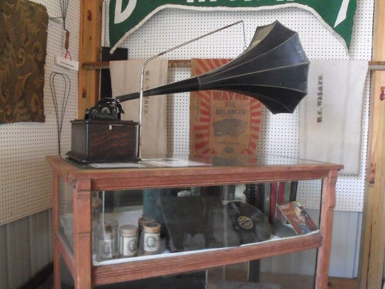 A working phonograph is set upon a case that contained