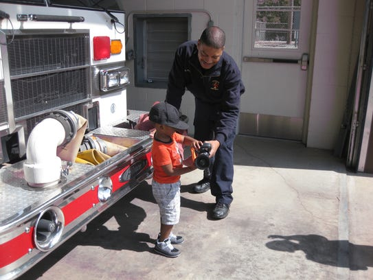 Chad Hart interacts with a child while on duty for