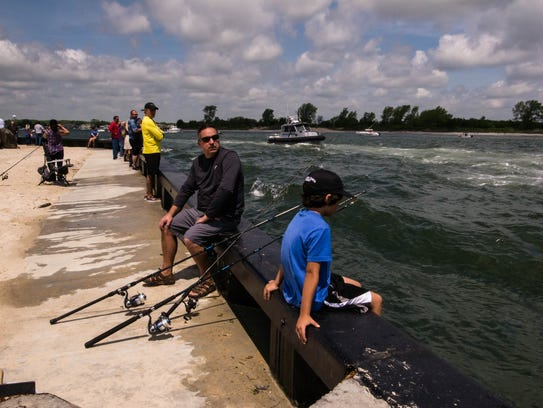Fans watch and cheer from the sidelines as the speedboats