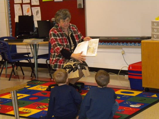 Coetta Ramsey reads to her second-grade students during