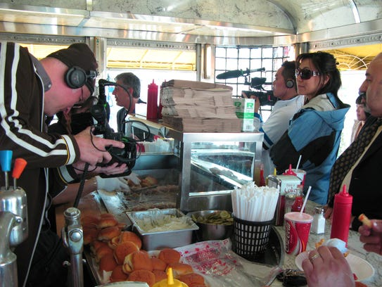 """The crew of """"No Reservations"""" films at White Manna"""