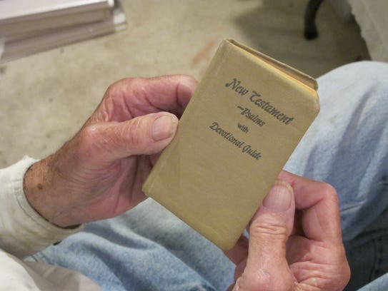 Richard Chilton holds the Bible his uncle Gordon Roberts
