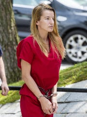 Jody Herring is led into Vermont Superior Court in Barre on Monday, Aug. 10, 2015, for arraignment on a murder charge relating to the killing of state social worker Lara Sobel. Herring now faces three more murder charges arising from the shootings of three relatives.