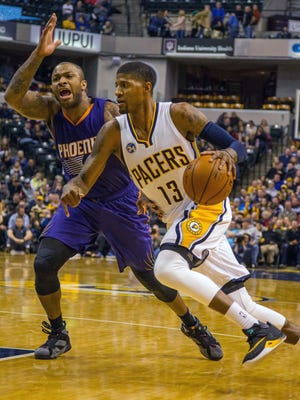 Jan 12, 2016: Indiana Pacers forward Paul George (13) dribbles the ball while Phoenix Suns forward P.J. Tucker (17) defends in the second half of the game at Bankers Life Fieldhouse. The Indiana Pacers beat the Phoenix Suns by the score of 116-97.