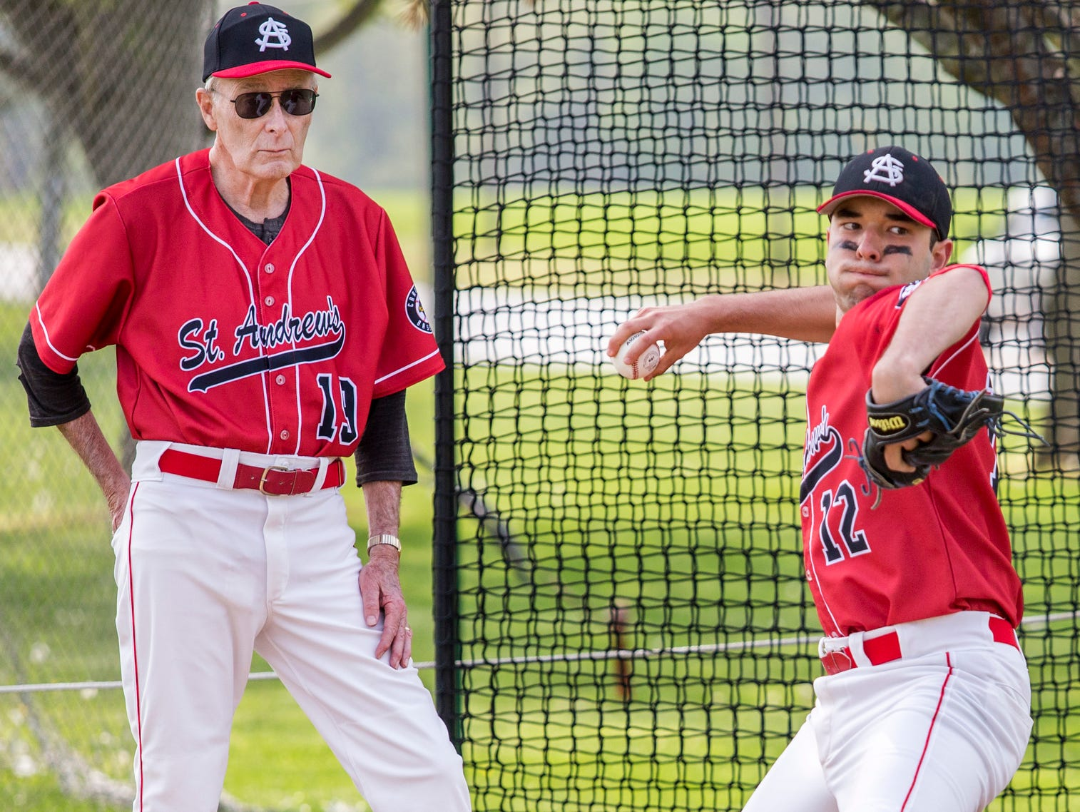 St. Andrew's head coach Bob Colburn watches as starting pitcher Colin Cool warms up before the start of a game at St. Andrew's School in Middletown on Thursday afternoon.