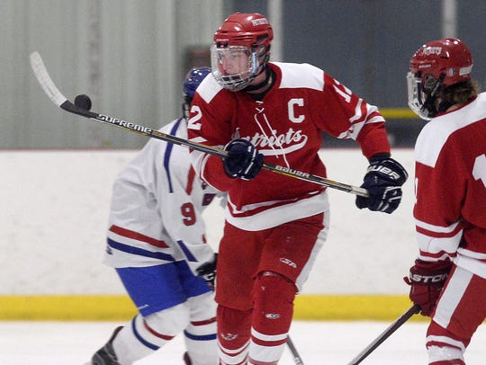 Penfield's Andrew Ebersol knocks down the puck on Tuesday,