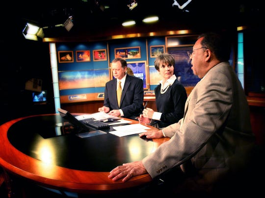 Dan Miller, left, Demetria Kalodimos and Bill Hall are on the set on Hall's last day before retiring on the air in 2005.