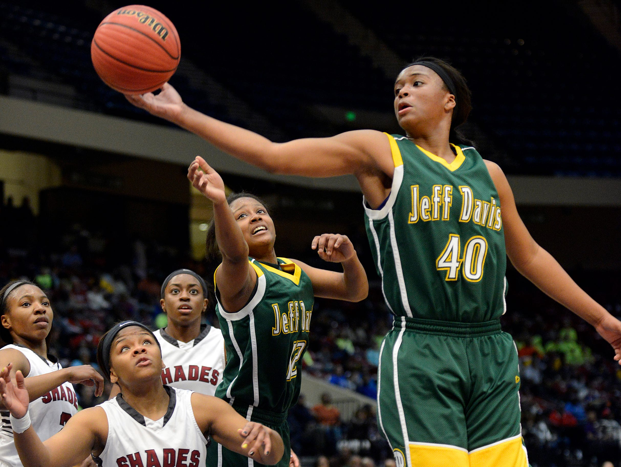 Jeff Davis' Jasmine Walker grabs the rebound during the AHSAA Final 48 semi-final 6A game at the BJCC in Birmingham, Ala., on Wednesday, Feb. 26, 2014. (Montgomery Advertiser, Amanda Sowards)