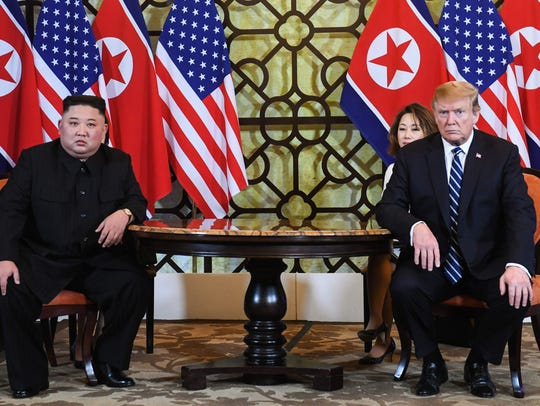 US President Donald Trump (R) and North Korea's leader Kim Jong Un hold a meeting during the second US-North Korea summit in Hanoi on February 28, 2019.