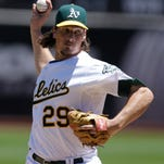 The Athletics' Jeff Samardzija delivers against the Blue Jays in the first inning Sunday.