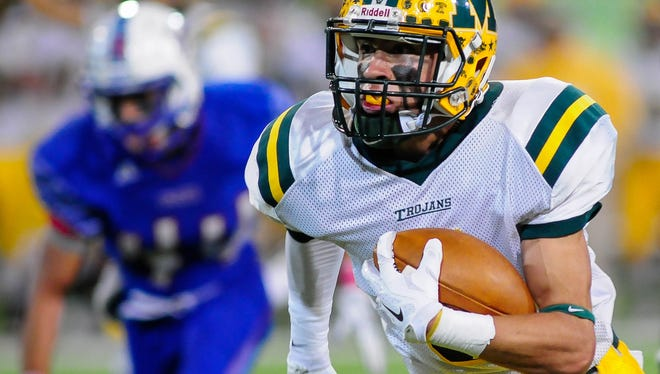 Ethan Alvarado runs with the ball on Friday at Aggie Memorial Stadium during the LCHS/MHS game.