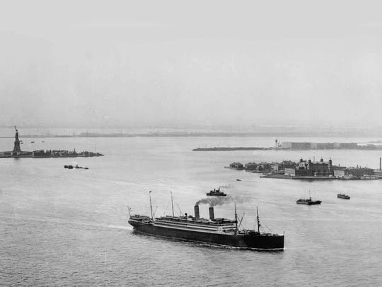 The Statue of Liberty on Bedloe's Island at left, and