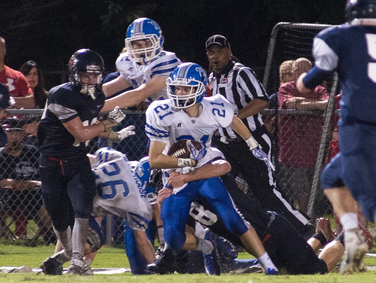 White House junior Kevin James fights for yardage during Friday's 14-7 loss to White House Heritage.