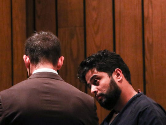 Anwar Ghazali, right, and his attorney, Blake Ballin, talk before the start of Ghazali's preliminary hearing on April 26, 2018.