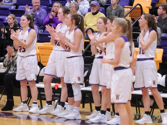 The Wylie bench celebrates during the final seconds of Friday's District 5-4A opening win against Brownwood. The Lady Bulldogs won 52-29.