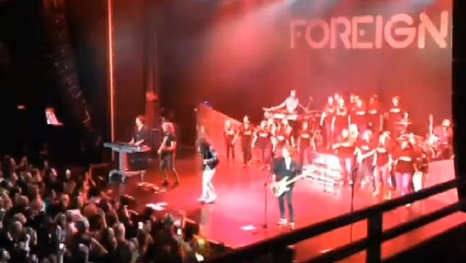 The Biloxi High School choir performed with Foreigner on Friday