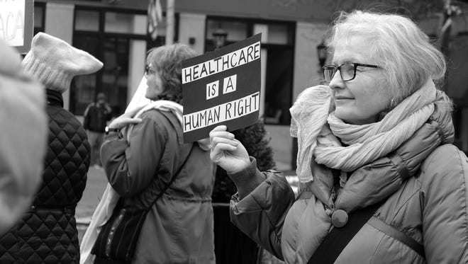 Yorker's gather on Continental Square to promote women's rights issues, Sunday, January 21, 2018. John A. Pavoncello photo