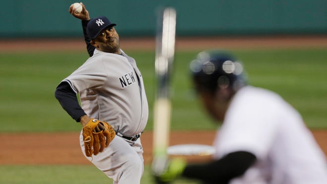 Yankees pitcher CC Sabathia delivers to Red Sox designated hitter David Ortiz in a battle they've waged intently for the last six seasons.