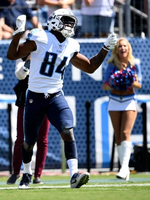 Titans wide receiver Corey Davis celebrates after a catch to set up their first score against the Raiders on Sunday, Sept. 10, 2017, at Nissan Stadium.