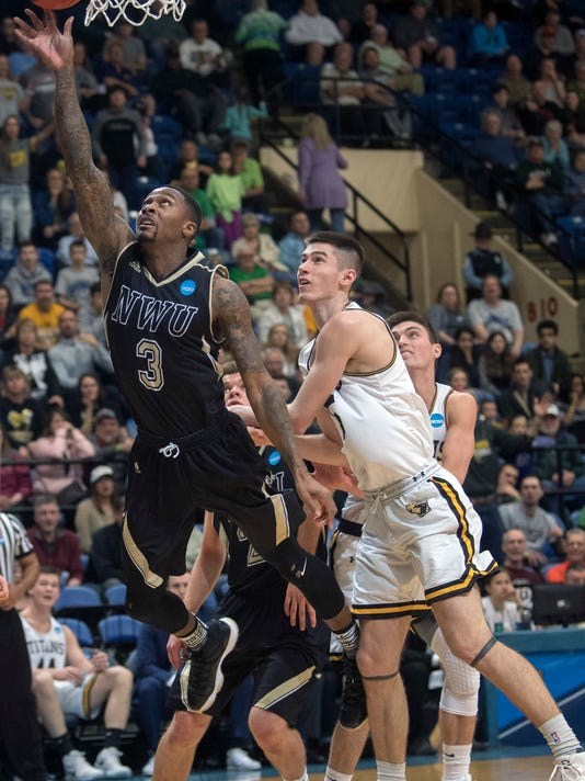 Nebraska Wesleyan forward Deion Wells-Ross (3) goes up for a basket against Wisconsin-Oshkosh forward Adam Fravert during the first half of the NCAA men's Division III championship college basketball game at Salem Civic Center in Salem, Va., Saturday, March 17, 2018. (AP Photo/Don Petersen)