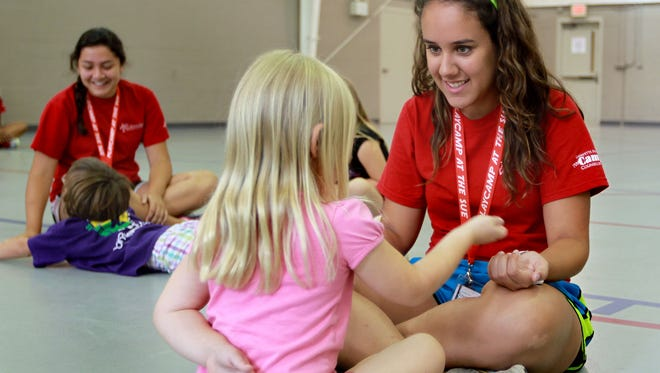 Teen volunteers, Danielle Lasanta, left and Selena Holm were once campers themselves and now they're giving back by volunteering at the Lafayette Park Summer Camp.