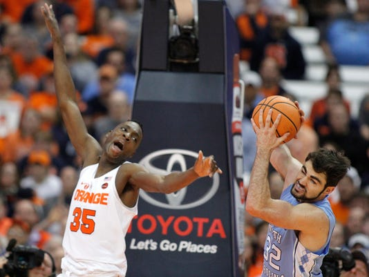 North Carolina's Luke Maye, right, grabs a rebound from Syracuse's Bourama Sidibe, left, during the first half of an NCAA college basketball game in Syracuse, N.Y., Wednesday, Feb. 21, 2018. (AP Photo/Nick Lisi)