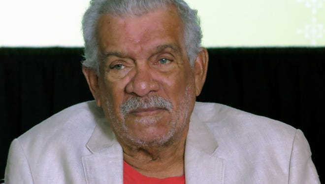 In this April 1, 2014 photo, Derek Walcott attends a news conference in Mexico City. The Nobel winner died early Friday, March 17, 2017, on the island of St. Lucia.