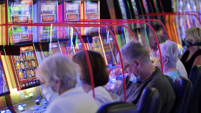Clear plastic dividers have been placed between slot machines at Presque Isle Downs & Casino, shown on the first day of re-opening under the green phase on June 26, 2020.