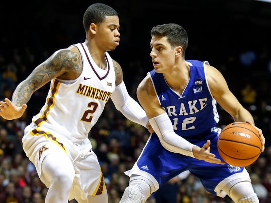 Minnesota guard Nate Mason (2) defends against Drake guard Reed Timmer (12) in the first half of an NCAA college basketball game Monday, Dec. 11, 2017, in Minneapolis. (AP Photo/Bruce Kluckhohn)