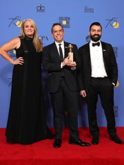 Darla K. Anderson, Lee Unkrich and Adrian Molina with