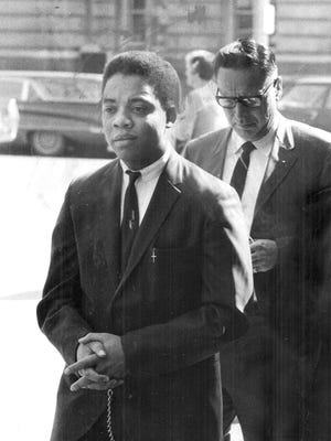 Robert Anthony Williams is led back to the Polk County Jail by Sheriff Deputy Robert Slycord after being found guilty for the murder of Pamela Powers, a 10-year old Urbandale girl. Williams was sentenced to life in prison after he abducted her from the downtown Des Moines YMCA on Dec. 24, 1968.