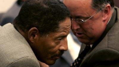 Bryan Lewis, right, speaks with former Metro council member Ludye Wallace.