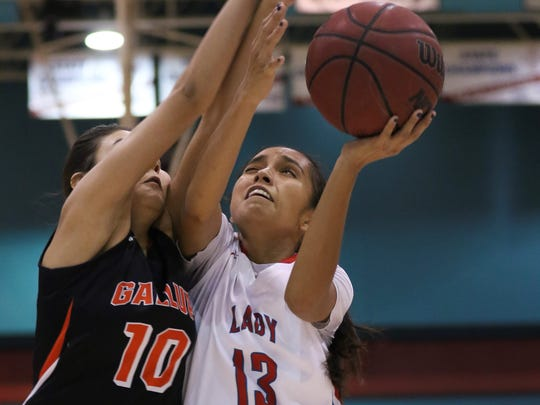 Shiprock's Paige Dale goes up for a shot against Gallup's Page Juan in the second quarter on Saturday at the Chieftain Pit Shiprock.