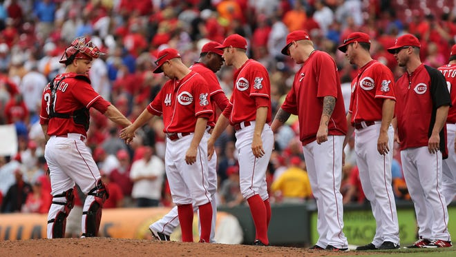 Players shake hands after the Cincinnati Reds beat the Los Angeles Dodgers at Great American Ball Park on Thursday.