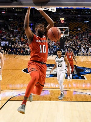 Texas Tech Red Raiders guard Niem Stevenson (10) dunks and scores against the Purdue Boilermakers during the second half in the semifinals of the East regional of the 2018 NCAA Tournament at the TD Garden.