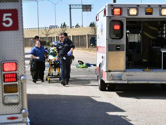First responders perform CPR on an elderly female pedestrian