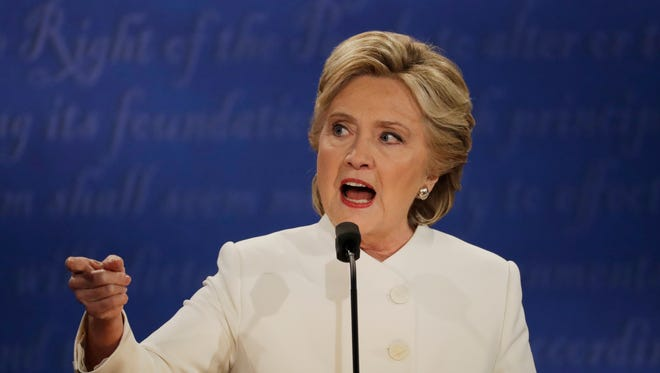 Democratic presidential nominee Hillary Clinton speaks to Republican presidential nominee Donald Trump during the third presidential debate at UNLV in Las Vegas, Wednesday, Oct. 19, 2016.