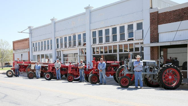 From left: Jerry Holle, Fred Watkins, Duane Geistmann, Ted Ahrens, Dale Duggan and Allen Andrae display their Farmall Tractors at the Gus Pruser Agriculture Exhibit in Winters, Texas. Pictured are a 1929 Farmall Regular, a 1938 Farmall F-20, a 1946 Farmall B, a 1946 Farmall H, a 1962 Farmall 560 and a 1967 Farmall 1206.