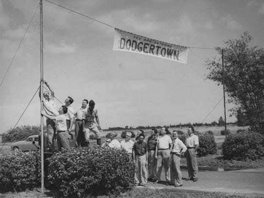 Banner being put up at the entrance to Dodgertown.