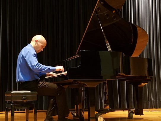 Anthony Molinaro performed at the Blake Library, presented