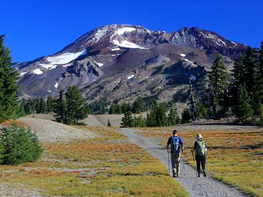 Two hikers head toward South Sister on the trail that leads up Oregon's third-tallest mountain.