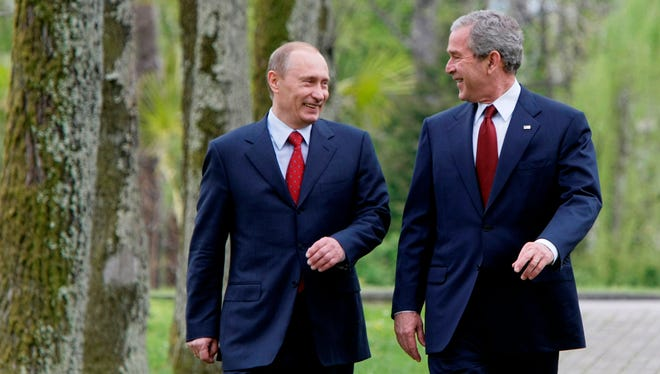 U.S. President George Bush, left, and Russian President Vladimir Putin walk to a joint press conference in the Black Sea resort city of Sochi, southern Russia, Sunday, April 6, 2008.