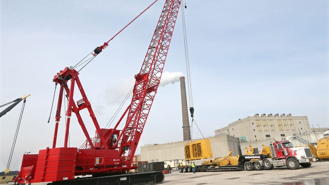 The Port of Milwaukee's Manitowoc crawler crane lifts components for a Caterpillar mining shovel in February 2017. The parts were to be shipped from the port in the spring.
