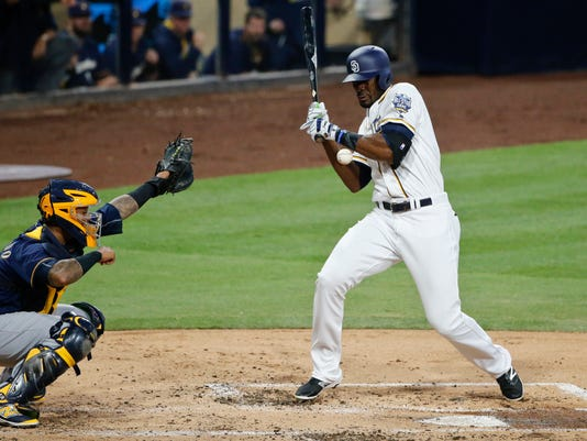 San Diego Padres' Jabari Blash takes a pitch off his arm while batting in the second inning against the Milwaukee Brewers in a baseball game, Monday, Aug. 1, 2016, in San Diego. (AP Photo/Lenny Ignelzi)