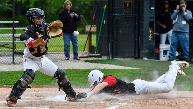 Pleasant's Bryce Pytlarz beats the ball and slides safe into home home plate for a run during the Pleasant versus Fairbanks game at Ohio Dominican University in Columbus on Wednesday.