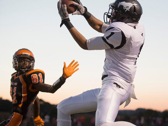 """South Western's Noah Straub beats Central York's Sakai Barton but comes down out of bounds Friday, Sept. 26, 2014.     JOHN WHITEHEAD for the Daily Record/Sunday News"""