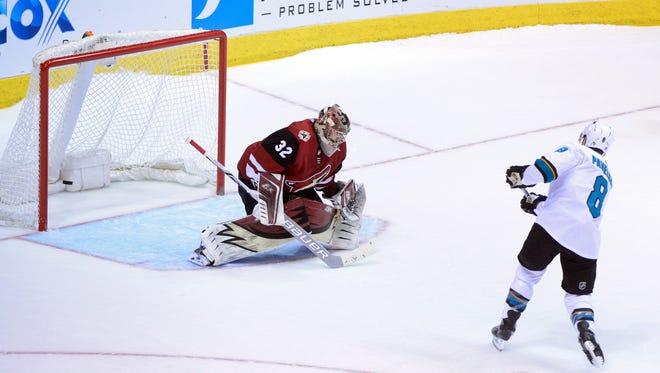 Jan 16, 2018: San Jose Sharks center Joe Pavelski (8) scores on Arizona Coyotes goalie Antti Raanta (32) during a shootout at Gila River Arena.