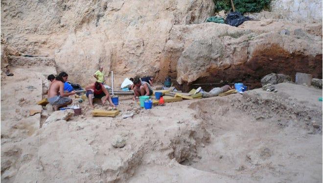 Researchers excavate a Neanderthal dwelling site called El Salt in southeastern Spain.
