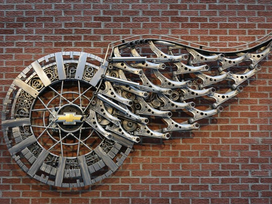The sculpture Wheels and Wings by Tomas Vitanovsky made of 186 Chevrolet parts hangs at concourse level at Little Caesars Arena in Detroit on Wednesday, Sept. 6, 2017.