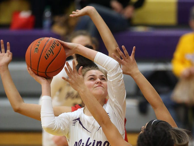 North Kitsap's Erin Pearson (20) goes up for a shot